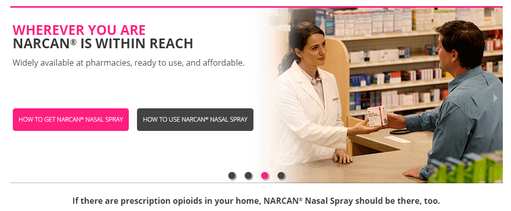 Image of pharmacist and patient holding a box of Narcan